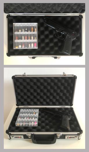 Pietro Librici, Bang Bang!, Aluminum weapon case, pills, plastic containers, Beretta M9 air pistol, 36x42x25 cm, 2019.