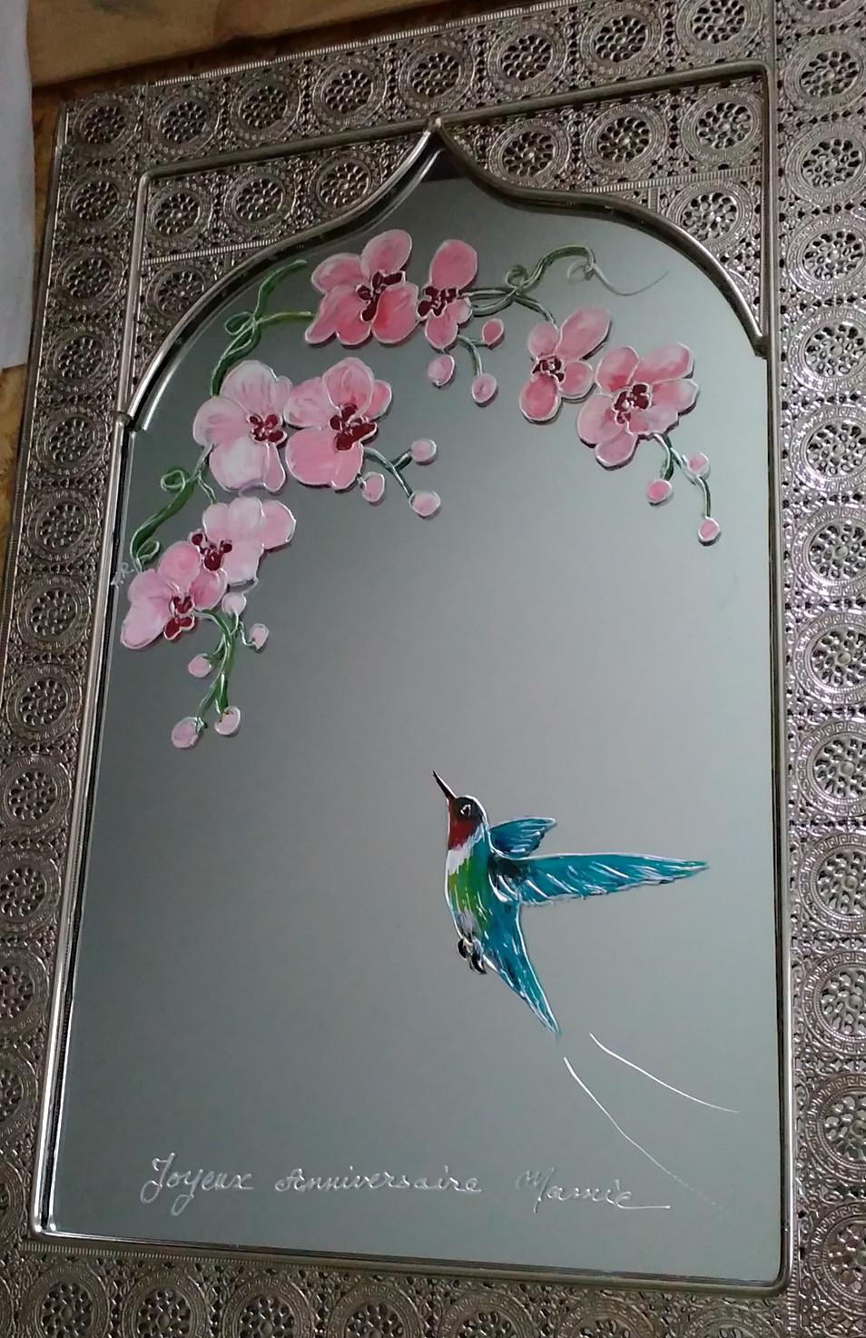 orchidée et colibri sur miroir