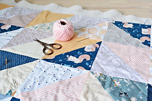 Hand stitch quilting process: pink cotto