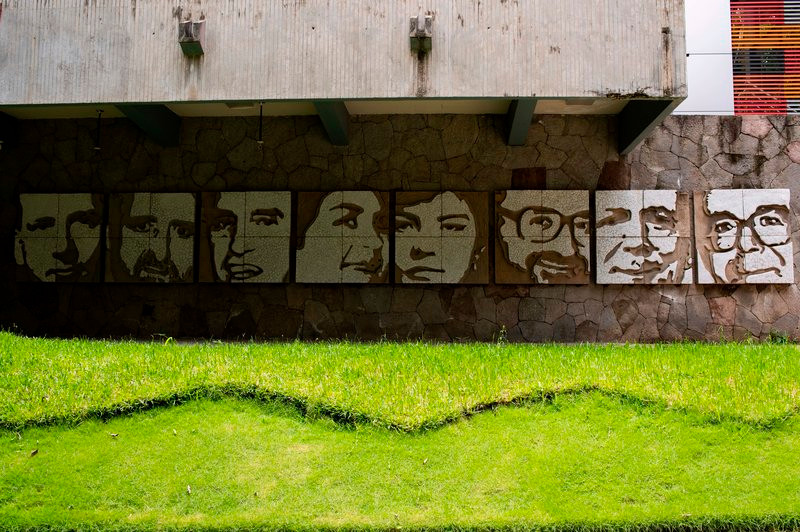 A mural made by artist Josué Villalta on the wall of a building of the José Simeón Cañas Central American University showing the faces of Jesuit priests who were executed by members of the Salvadoran army in 1989. Yuri Cortez/AFP via Getty Images