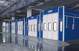row of old models of Firat spray booths with 3 leaf door, new models include 4 leaf door spraying painting drying booths oven