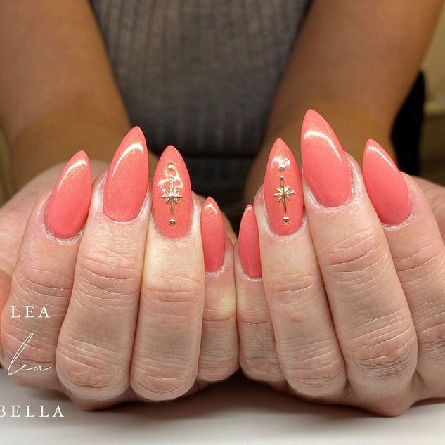 coral stiletto nails.jpg