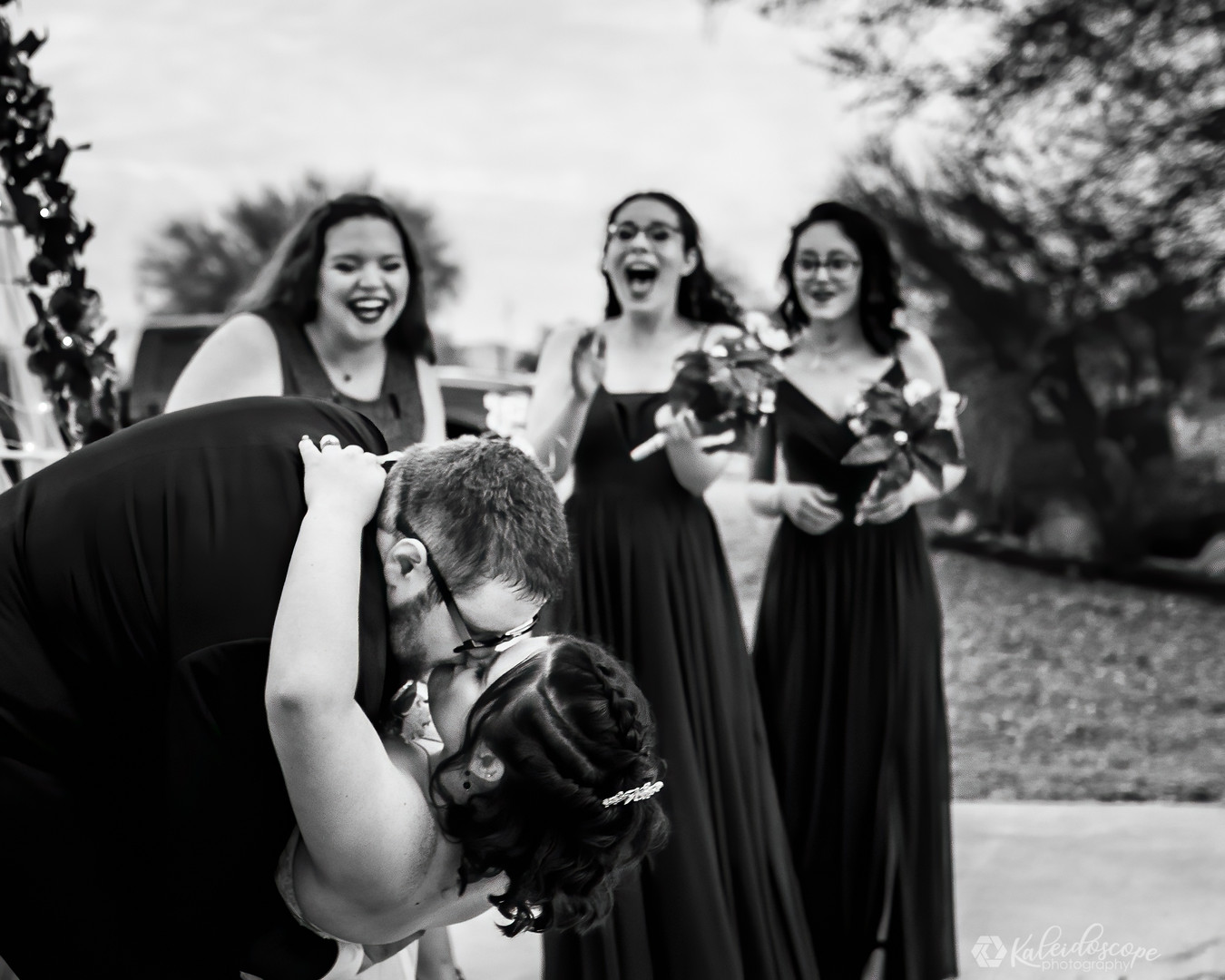 groom-dipping-bride-black-and-white.jpg