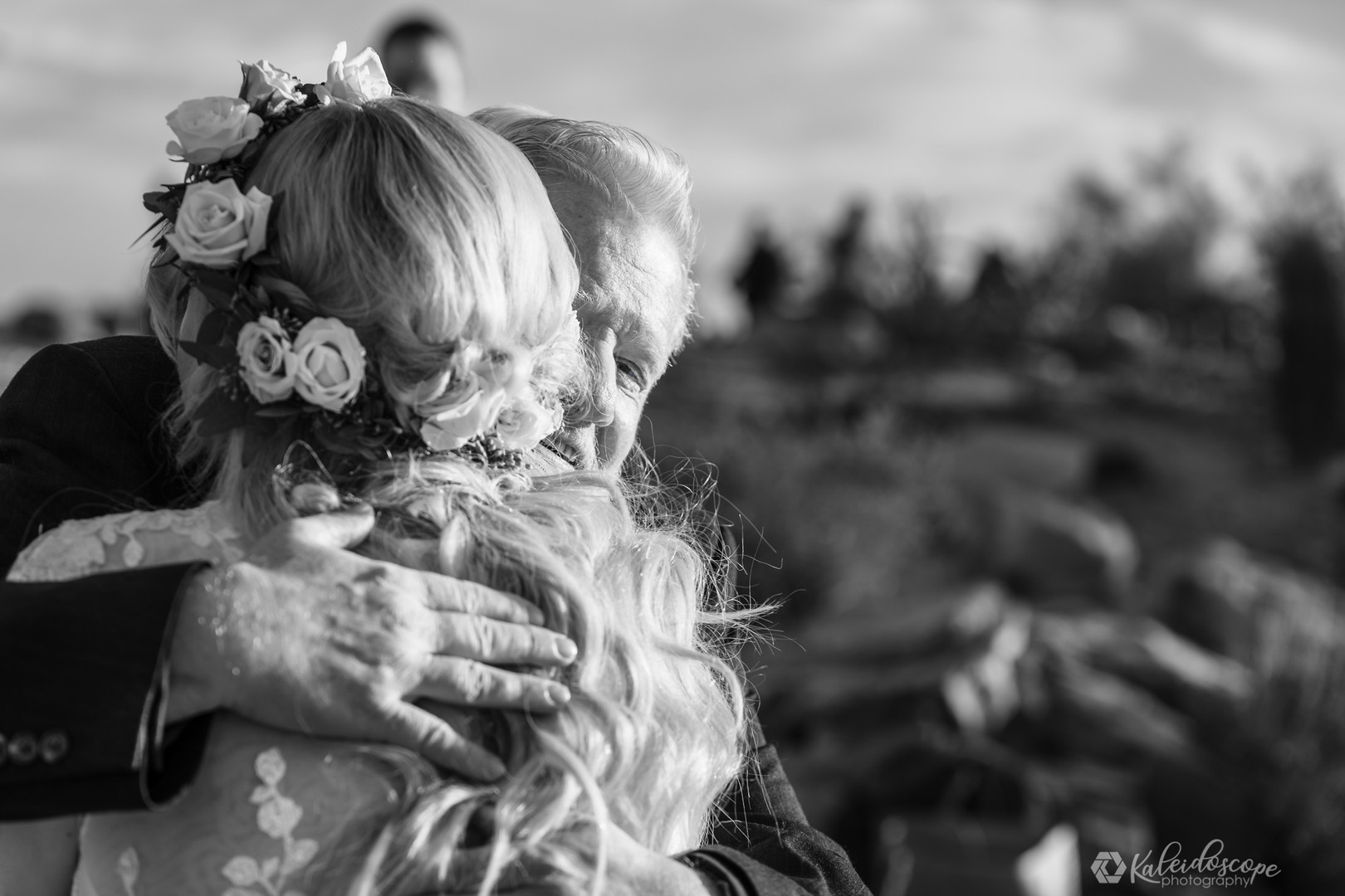 father-hugging-bride-elopement.jpg