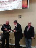 Agora Director Don delivering Staner Award to Sam