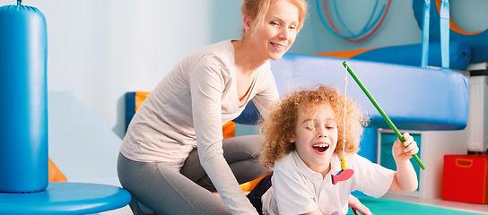 Happy kid playing with his sensory integ