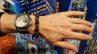 NEXT IDEA BY SRC on his wrist