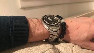 Life Symphony Of TSA on his wrist