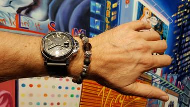 IDEA BY SRC on his wrist