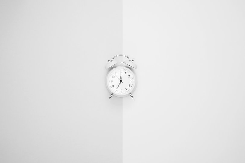 Blue clock on a pastel background_edited