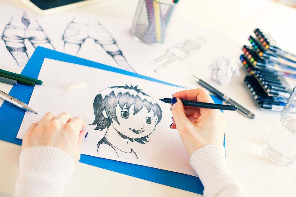 woman drawing an anime figure