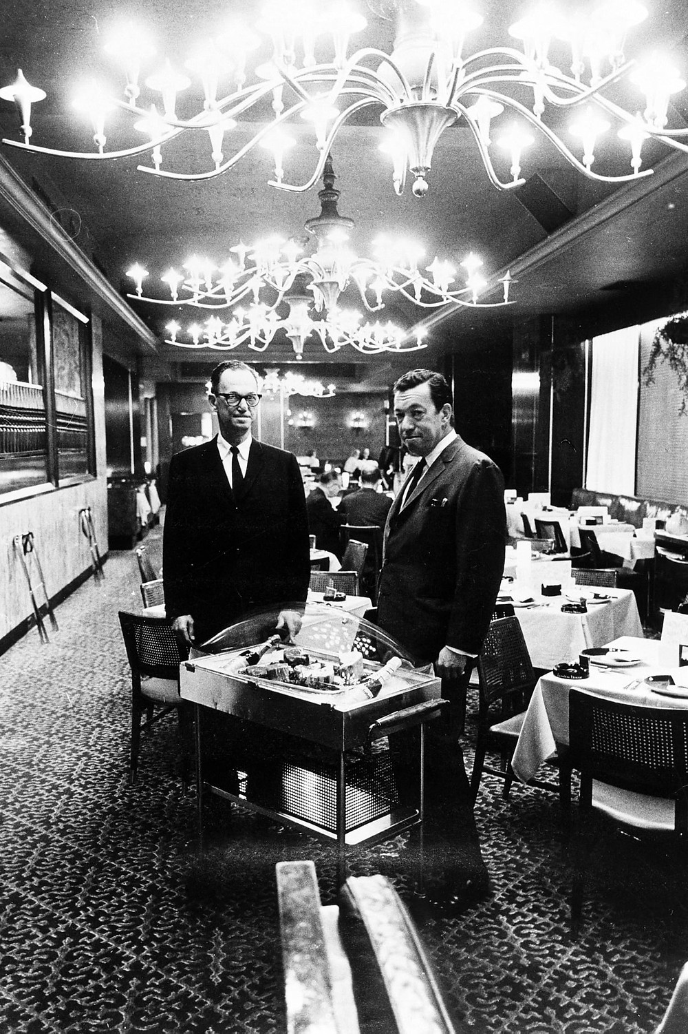 Owners George and Oscar Marienthal inside the London House dining room in the early 1960s.
