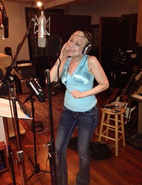 Laury singing at a recording session for her album.