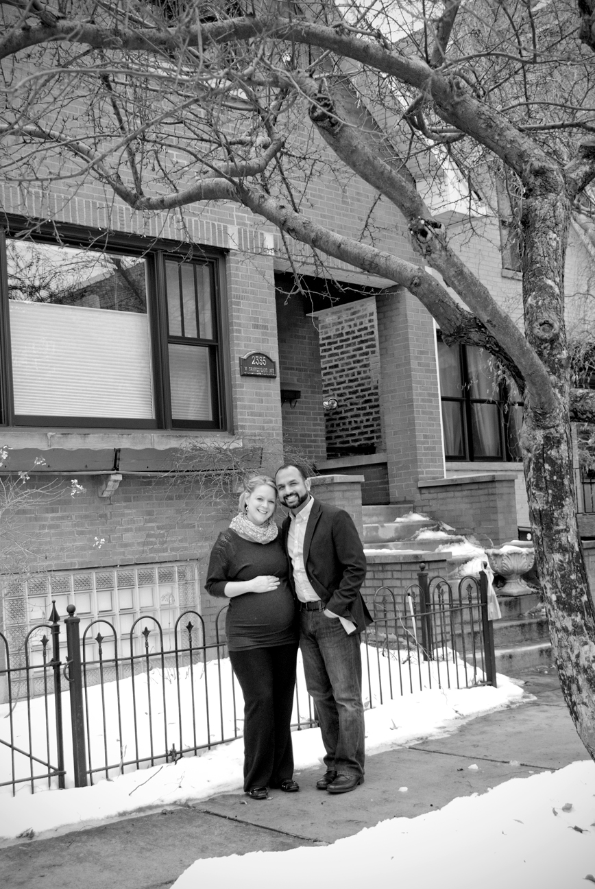 Mom and Dad in Front of House Black and White