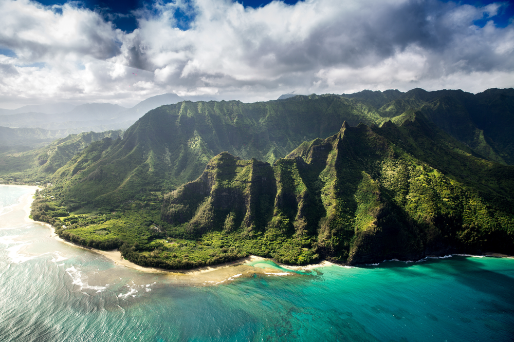 natural wonders, Hawaiian culture,  ocean, volcanoes, jungles, mountains, beaches, islands, native birds, waterfalls to behold here; Kahuna Falls (100 feet), Akaka Falls (442 feet), and the monstrous Hiilawe Falls (1450 feet).  hula dancing, outrigger canoeing, and surfing come alive.  spiritual experience, beautiful hiking trails, craters, rainforest, and calderas while Kilaue,  tropical landscape. Islands of Hawaii: Akaka Falls State Park, Volcanoes National Park, Waikiki