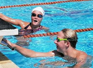 "Swimmers  Survive ""Grinch Week"""