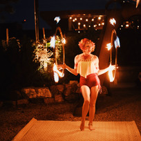 Fire dancing at a Caribbean cruise themed private dinner in Denver