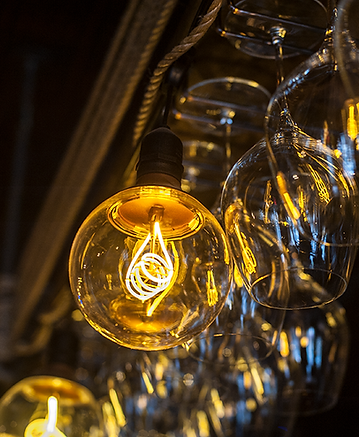 This is an image of an edison bulb and the wine glasses