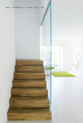 stairs design : a wood covering with glass parapet.