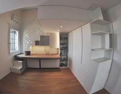La camera si trasforma in uno studio con zona notte