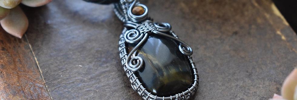 Collier Homme wire Gris Anthracite en Oeil de Faucon de forme rectangulaire