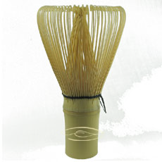 A bamboo whisk is used to mix the matcha tea powder into a frothy drink