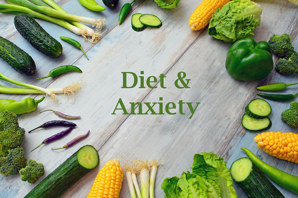 different vegetables arranged in a circle around the words diet and anxiety