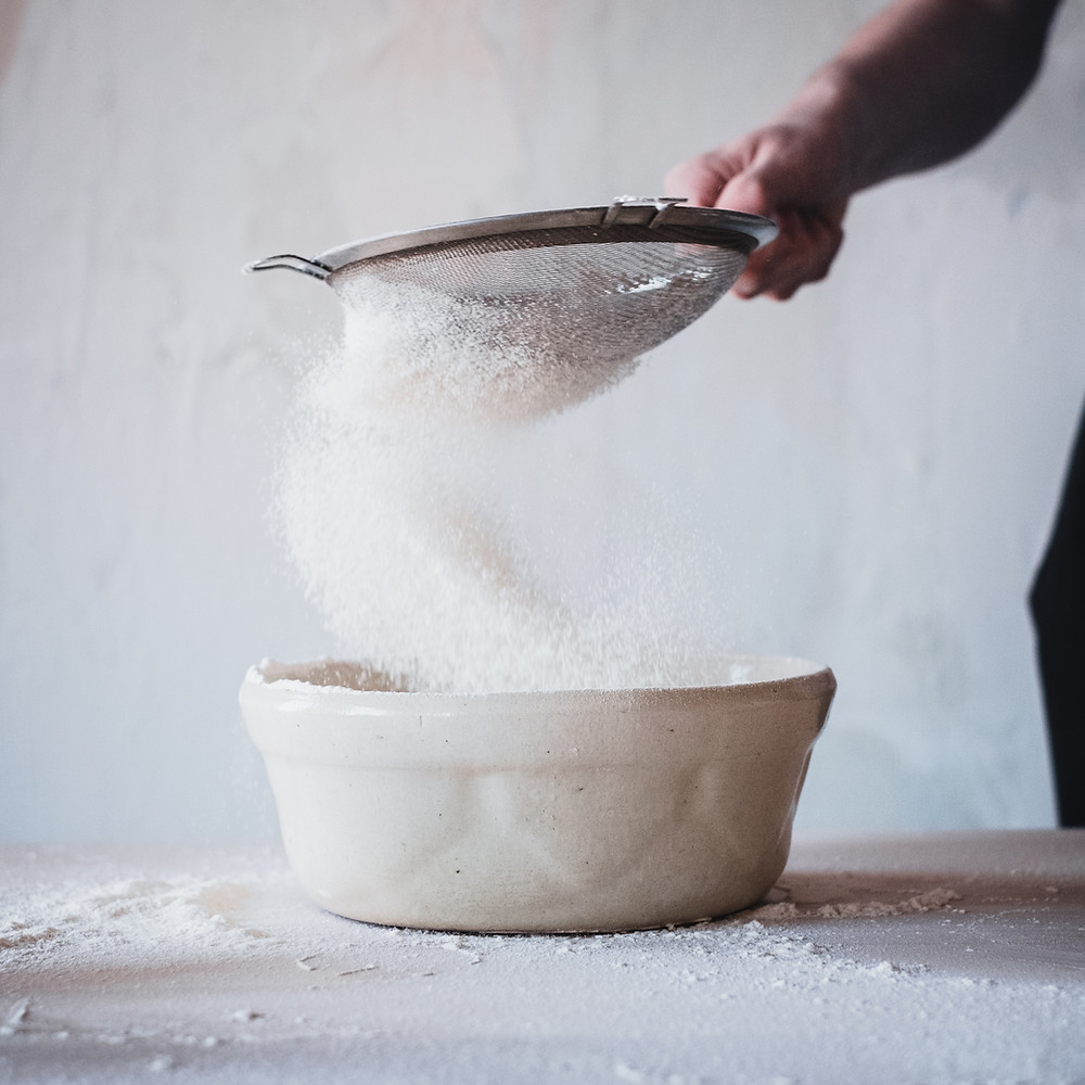 picture of bowl of sugar being sifted