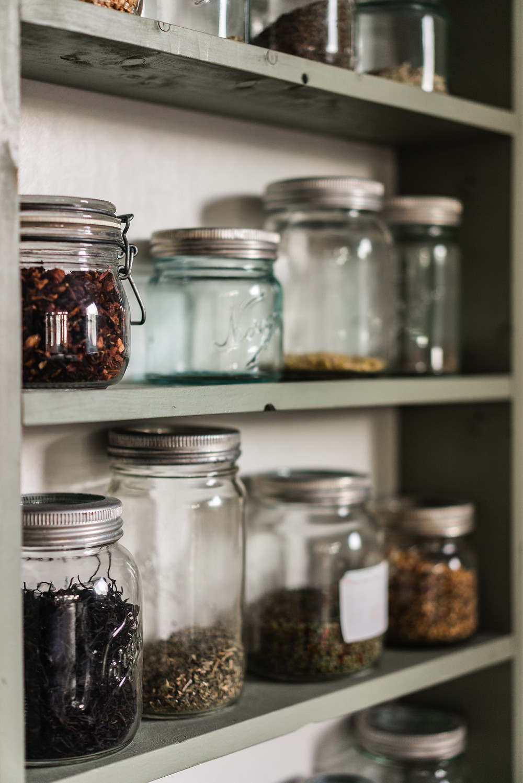 glass jars displayed on shelves