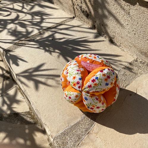 Balle de Préhension - MONTESSORI - ORANGE fleurs avec grelot