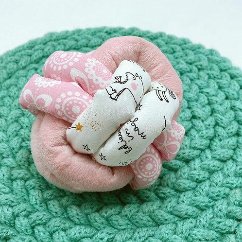 Balle de Préhension - NOEUD DOUBLE - ROSE PALE licorne phospho. avec grelot