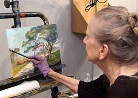 Elaine with artwork at Kline Academy