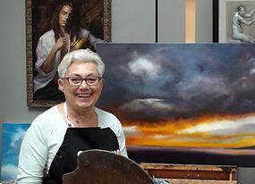 Nancy with artwork at Kline Academy