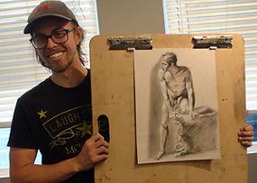 Norbert with artwork at Kline Academy