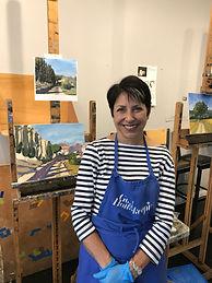 Charlene with artwork at Kline Academy