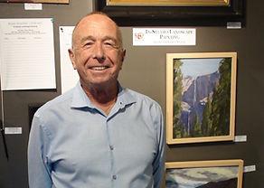 Eliott with artwork at Kline Academy