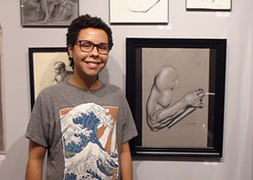 Lucas with artwork at Kline Academy