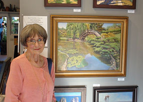 Janice with artwork at Kline Academy