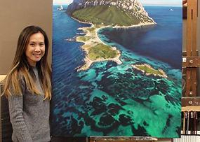 Susan with artwork at Kline Academy