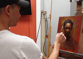 Jong with artwork at Kline Academy