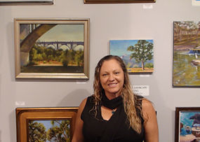 Jessica with artwork at Kline Academy
