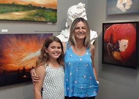 Venelina with artwork at Kline Academy