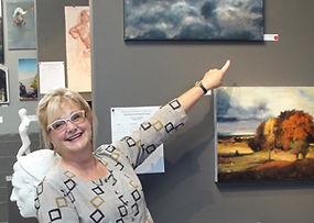 Sarah with artwork at Kline Academy