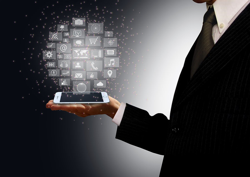 stockvault-businessman-holding-a-smartphone-with-information-technology-holograph180397.jpg
