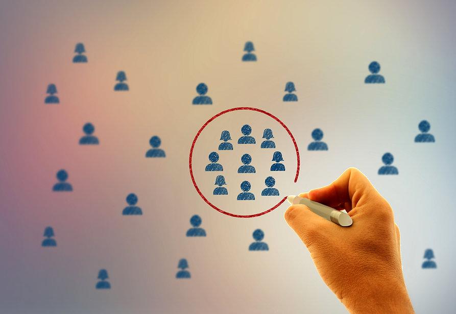 stockvault--businessman-drawing-a-circle-around-people-icons178079.jpg