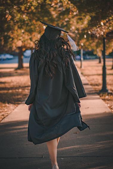 woman-in-black-long-sleeve-dress-standin