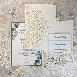 Ivory laser cut with greenery