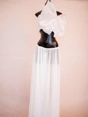 Bianca. White. Can be worn with or without bow.
