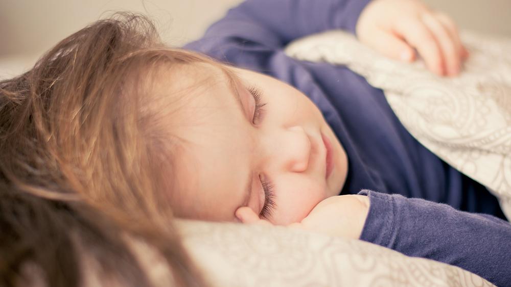 A child sleeping. Magnesium improves sleep.
