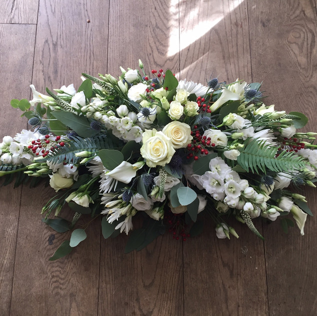 casket spray in white with red and blue